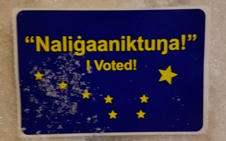 "Sticker in snow reads ""'Naligaaniktna!' I voted!"""
